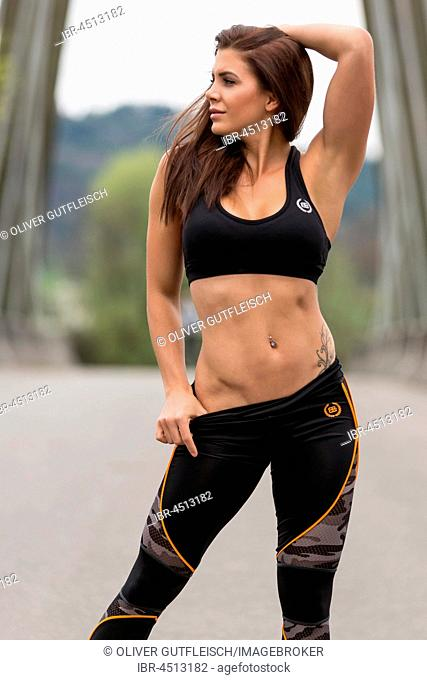 Young woman in sporty outfit