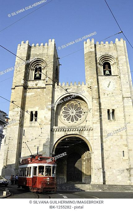 Red tram in front of the Catedral Sé Patriarcal cathedral, Lisbon, Portugal, Europe