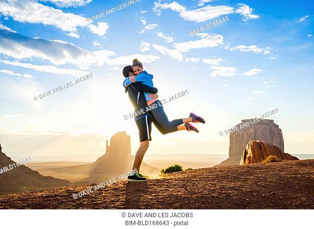 Caucasian couple hugging in Monument Valley, Utah, United States