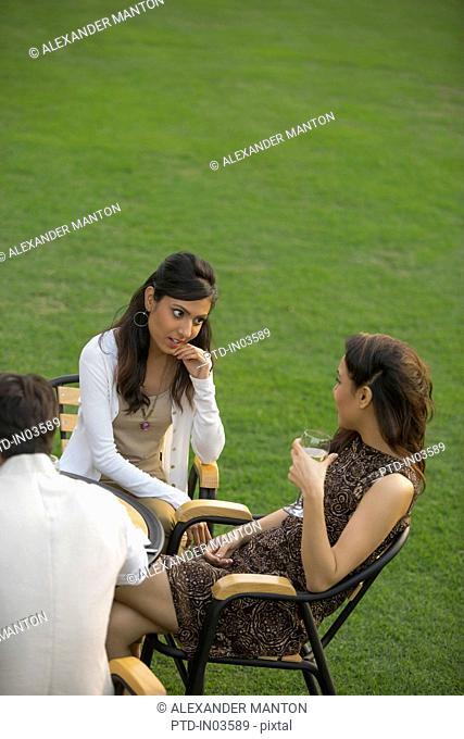 Two girls talking in garden