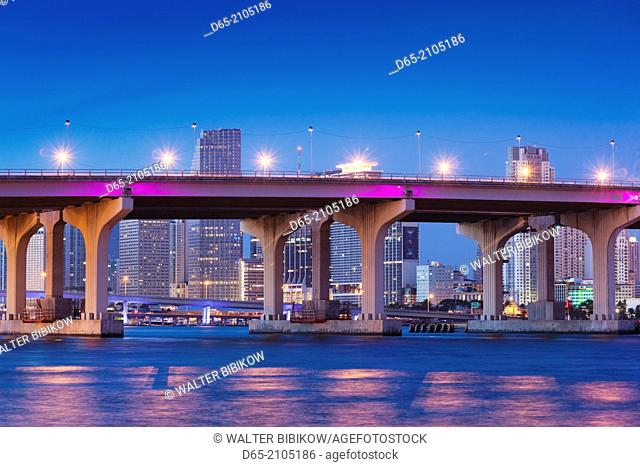 USA, Florida, Miami, city skyline from Venetian Causeway, dawn