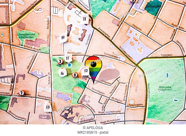Close-up of gay pride symbol on map representing planning on parade