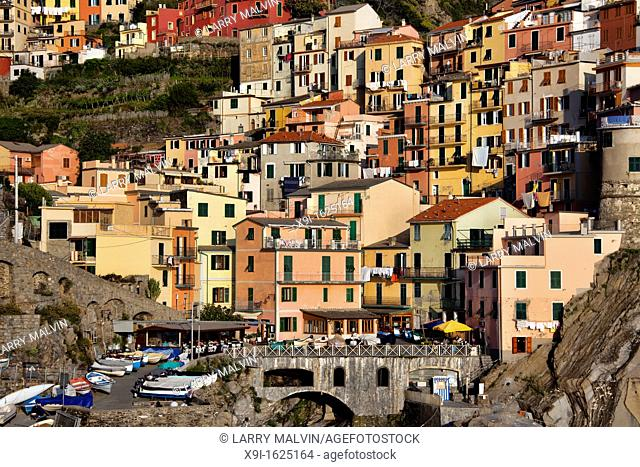 Close in view of Manarola with bridge and colorful buildings in the late afternoon along the Cinque Terre region of Italy