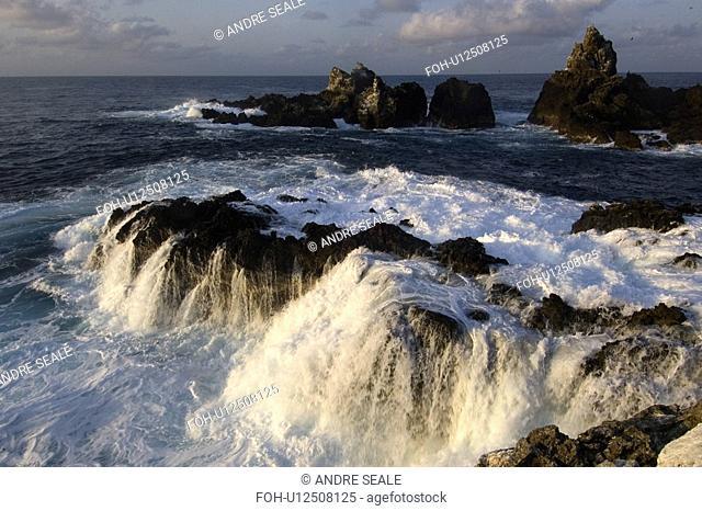 Wave crashing over rock, St. Peter and St. Paul's rocks, Brazil, Atlantic Ocean