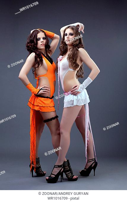 two Beauty sexy go-go dancers stand portrait