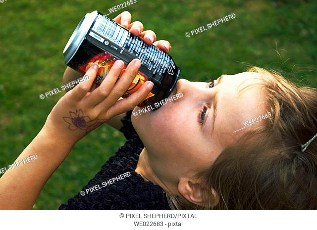 Girl drinking can of pop