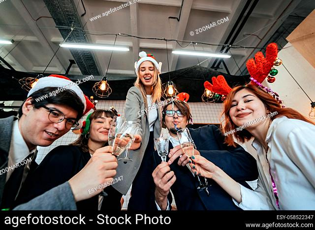Happy colleagues in office celebrate special event together, smiling diverse work team have fun laugh. Friendship concept