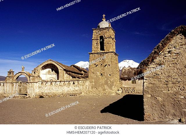Bolivia, Oruro department, Sajama province, Sajama National Park, Sajama, 16th century colonial church and Parinacota and Pomerape volcanoes in the background
