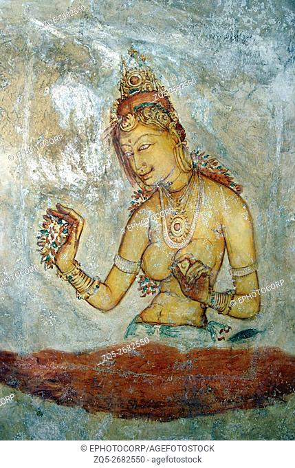 Sigiriya - Sri Lanka, Frescoes on the West rock face, showing Apsaras holding garland. 5th. Cent. A. D