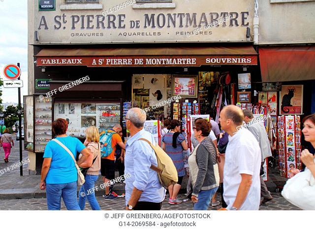 France, Europe, French, Paris, 18th arrondissement, Montmatre, Place du Tertre, Rue Norvins, man, woman, souvenir shop, shopping, sale,