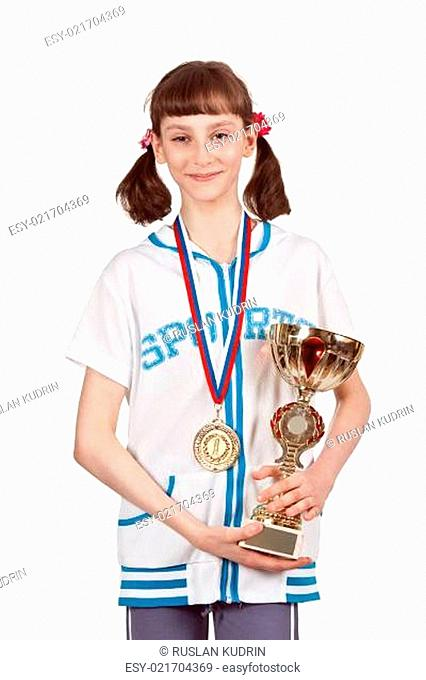 Girl with a medal and a gold cup