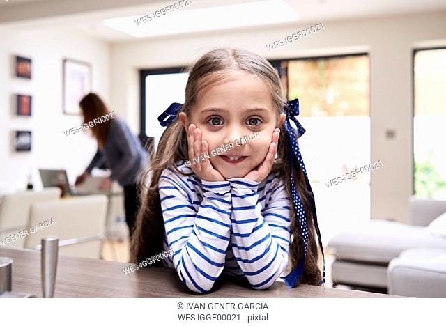 Portrait of smiling little girl at home