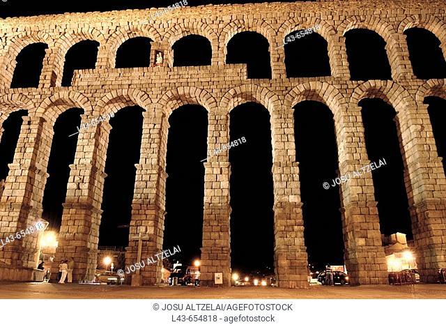 Roman aqueduct at night, Segovia. Castilla-León, Spain