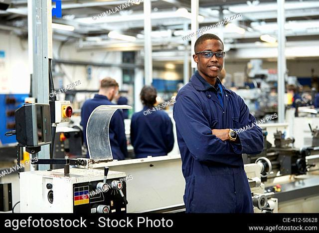 Portrait confident teenage boy student in shop class