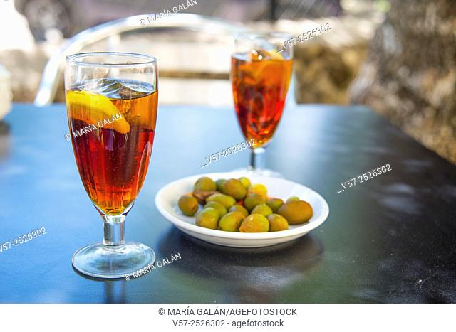 Spanish aperitif: two glasses of vermouth with green olives
