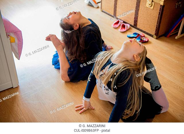 Girls stretching with toes touching heads