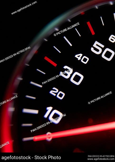 22 March 2020, Bavaria, Nuremberg: The illuminated speedometer of a car. Photo: Daniel Karmann/dpa. - Nuremberg/Bavaria/Germany