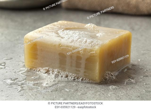 Wet piece of traditional Moroccan soap with foam for hamam