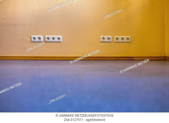 Blue floor and orange wall with