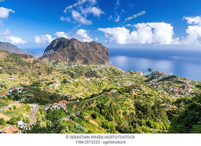 The northern coast of Porto da Cruz with Penha da Ã. guia seen from the Miradouro Porto da Cruz, Madeira, Portugal