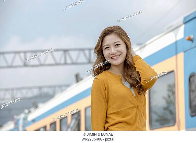 Portrait of young smiling female traveler