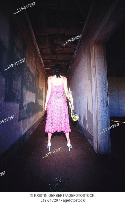 Woman in dark corridor