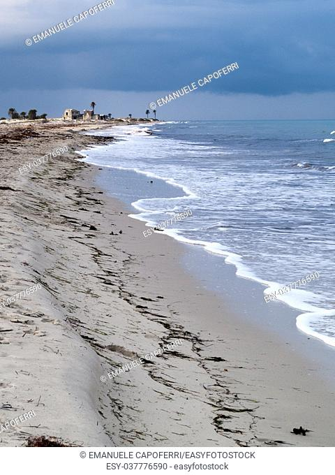 Djerba, Tunisia, beach with sea and waves, cloudy and threatening sky, a storm is coming, winter