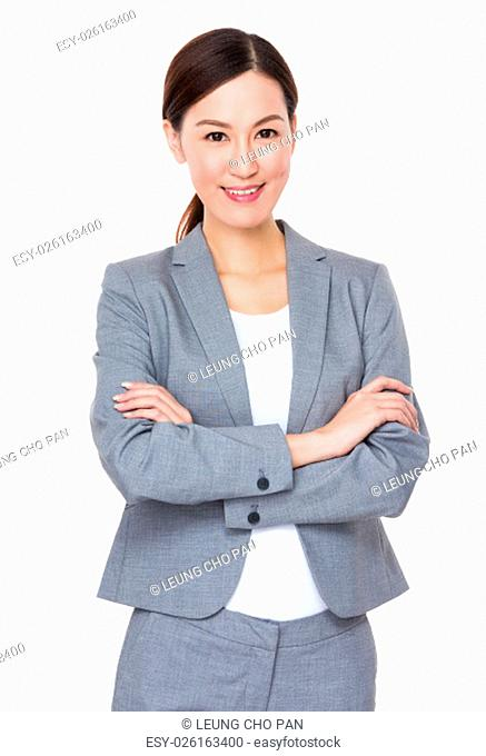 Young businesswoman with armed crossed