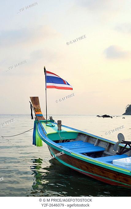 fishing boat at dusk at Kata Beach, Phuket