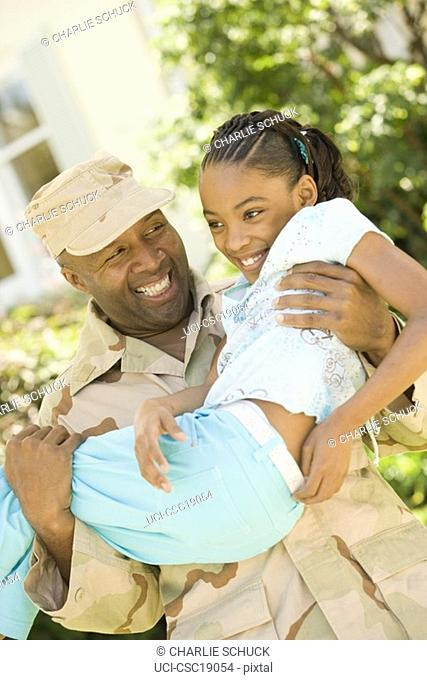 African military soldier holding his daughter