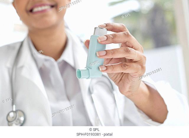 Female doctor holding inhaler