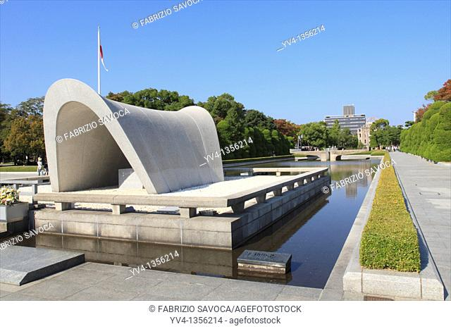 Memorial Cenotaph, Hiroshima Peace Memorial Park, Hiroshima, Japan  Near the center of the park is a concrete saddle shaped monument that covers a Cenotaph...