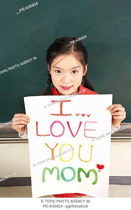 Student Holding 'I LOVE YOU MOM' Sign