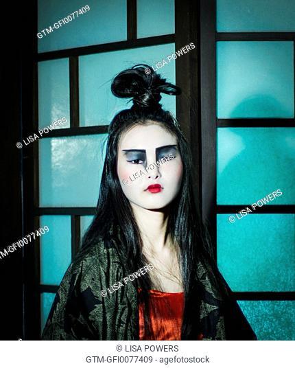 Beautiful young Japanese woman wearing red dress and kimono