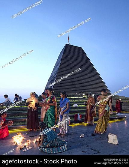 View at dusk with villagers lighting up temple with candles. Balaji Temple, Andhra Pradesh, India. Architect: Sameep Padora and associates , 2020