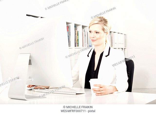 Businesswoman working at desk in the office