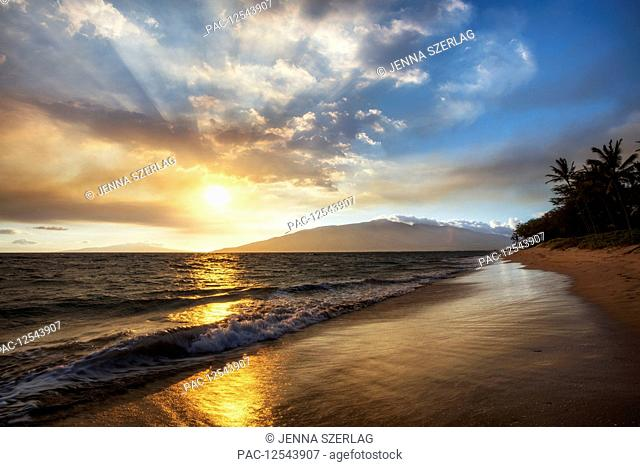 A sunset view with soft water from North Kihei; Maui, Hawaii, United States of America