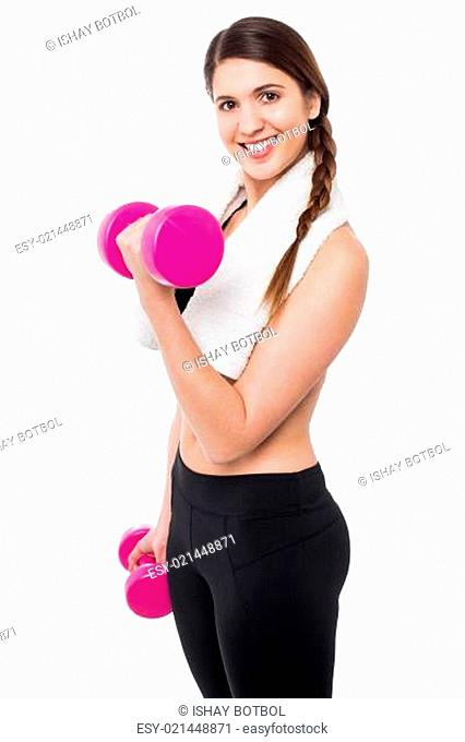 Young girl lifting dumbbells, biceps exercise