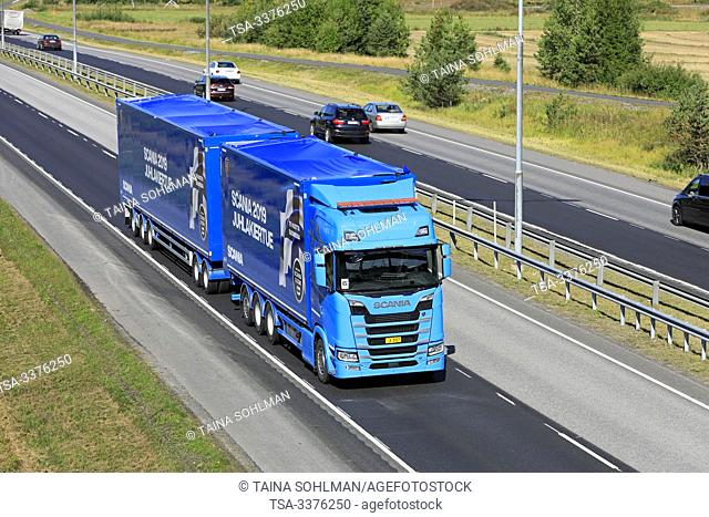 Turku, Finland. August 24, 2019. Blue Next Generation Scania S650 truck pulls full trailer in road test, above view. Scania in Finland 70 years tour