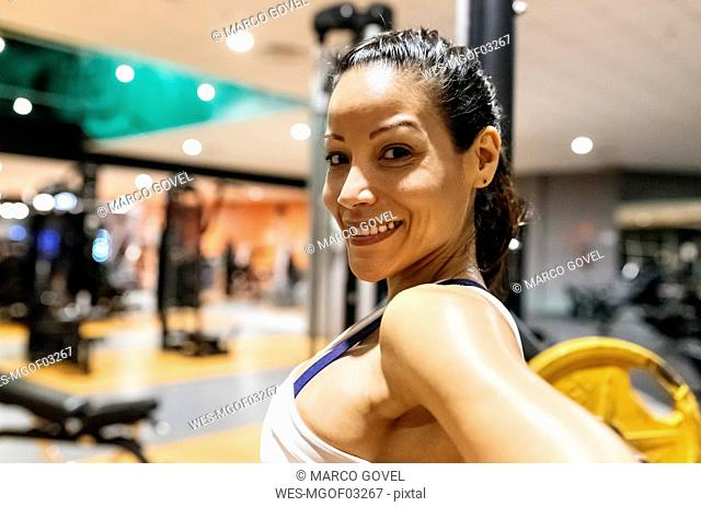 Smiling woman after work out in the gym