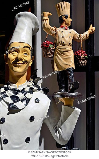 Funny cookers statues outside a restaurant, Florence, Tuscany, Italy