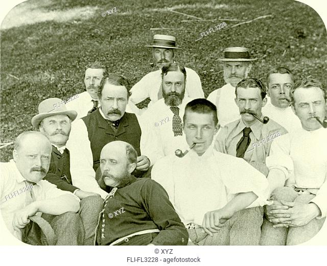 Group portrait of men seated outdoors