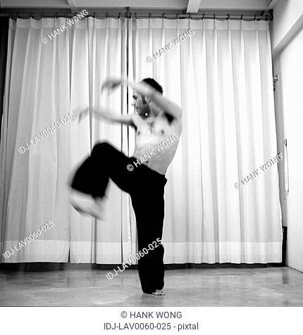 Male dancer practicing in a studio