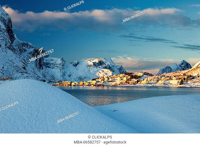 The blue color of dusk on the fishing village and the snowy peaks Kvalvika Andøya Reine Nordland Lofoten Islands Norway Europe