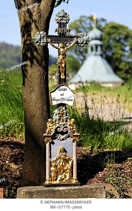 Cross in Neukirchen bei Heilig Blut , inscription Gelobt sei Jesus Christus , Upper Palatinate , Bavaria Germany