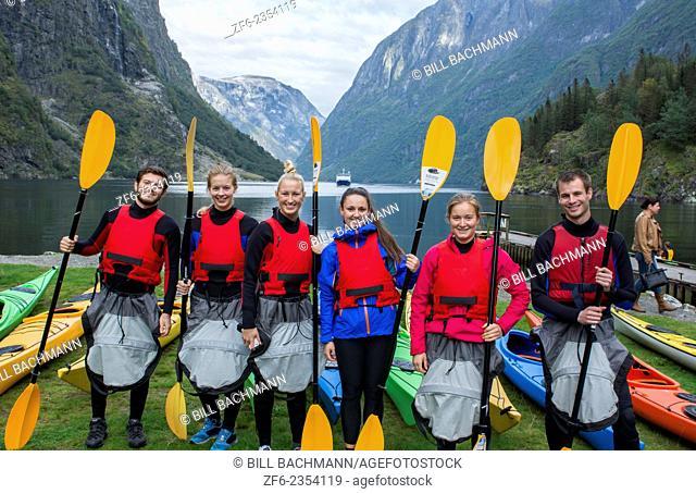 Gudvangen Norway fjord called Naeroyforden Fjord portrait of college students getting lesson on paddling kayaks as sport MR-7