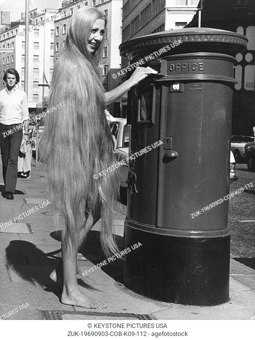 Sep 3, 1969 - London, England, United Kingdom - The longest wig in the world, the 'Godiva' wig, is modeled by 19-year-old Holly O'Neill as she posts a letter...
