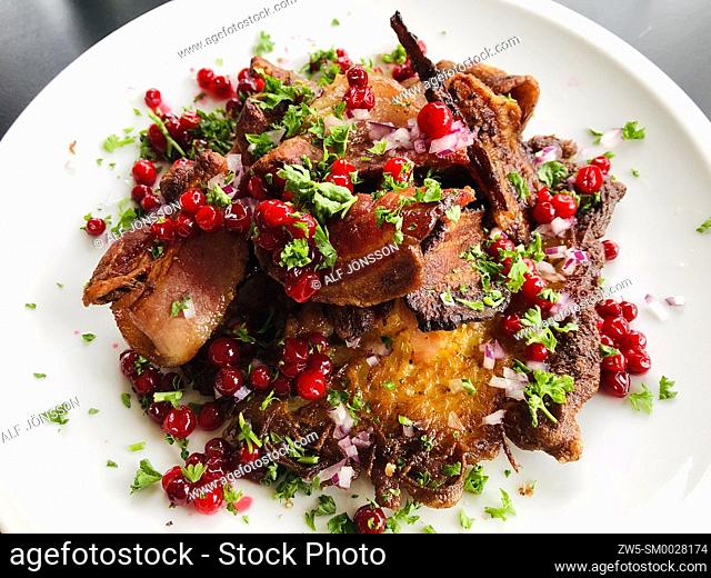 "Fried pork with potatoe and red lingonberry, """"Raggmunk"""" a Swedish traditional meal"