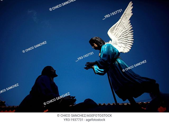 A silhouette of Jesus Christ praying in front of an angel is displayed at the Señor Sepultado procession during Easter Holy Week in Antigua Guatemala