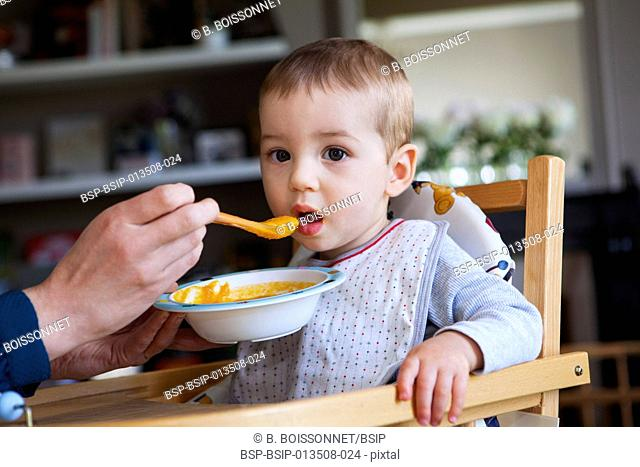 CHILD EATING A MEAL